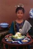 Northern Thailand has inherited the culinary legacy of the once powerful Lan Na Kingdom, with ties to neighbouring Burma and the Chinese province of Yunnan. One noteworthy feature is the widespread use of tomatoes in curries and other cooked dishes – elsewhere in Thailand the tomato is usually seen as a salad vegetable.<br/><br/>  Distinctive dishes include khao soy – a succulent noodle dish introduced by Muslim caravaneers from China. Wheat noodles are served in a chicken or beef broth with an accompaniment of chopped red onions, pickled cabbage, fresh lime and soy sauce. Nam phrik ong – minced pork with tomatoes and chillies, almost like a Bolognese sauce. Not to be missed is kaeng hang lay – curried pork with ginger and peanuts, often served at weddings and other celebrations. Another favourite is the spicy Chiang Mai sausage, made with naem, or preserved pork. Served with a tray of peanuts, fresh ginger and chilli peppers, Northerners consider this to be an ideal kap klaem, or accompaniment to drinks – usually whisky and soda with plenty of ice.<br/><br/>  Visitors to Chiang Mai can sample local cuisine at a northern Khantoke dinner – elegantly served on a low table, usually to the accompaniment of traditional Lan Na dancing.